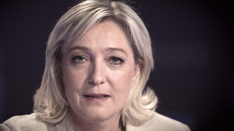 La candidate FN à l'élection présidentielle, Marine Le Pen, intervient sur un plateau télévisé, le 17 février 2012. (JOEL SAGET / AFP PHOTO)