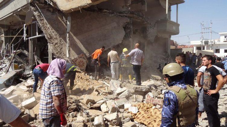 Après un attentat à la voiture piégée à Kirkouk (Irak), le 7 août 2014. (MARWAN IBRAHIM / AFP)