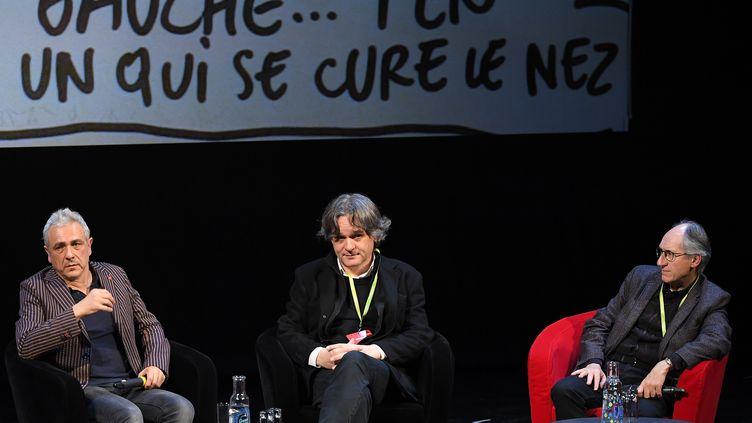 Larédaction de Charlie Hebdo, à Strasbourg le 2 novembre, lors d'une rencontre avec le public, inédite depuis l'attentat de 2015, pour réaffirmer le rôle de la presse satirique et de la caricature. (PATRICK HERTZOG / AFP)