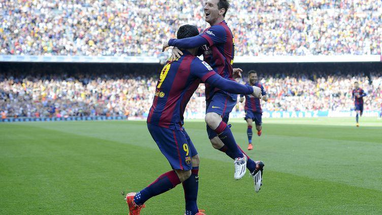 Face à Valence, Lionel Messi a délivré une passe décisive pour Luis Suarez avant d'inscrire son 400e but sous le maillot du Barça. (JOSEP LAGO / AFP)
