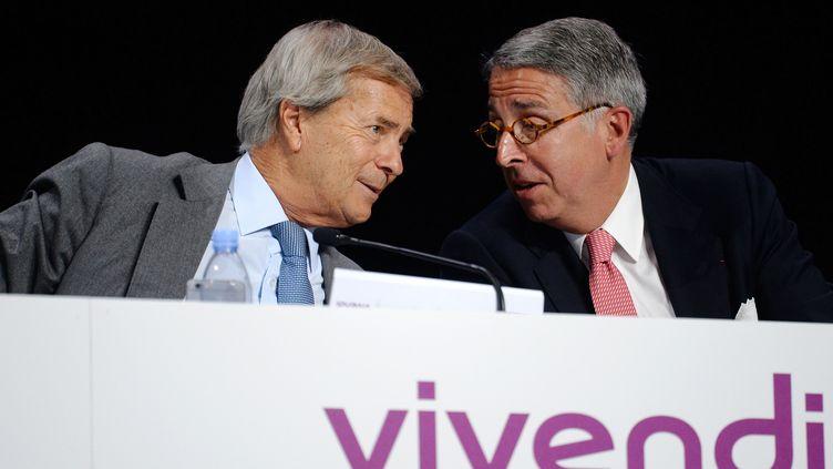 Vincent Bolloré (à gauche), PDG du Groupe Bolloré, actionnaire majoritaire de Vivendi.  (AFP / ERIC PIERMONT )