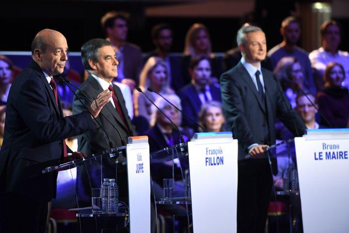 Alain Juppé, François Fillon et Bruno Le Maire lors du deuxième débat télévisé (ERIC FEFERBERG / AFP)