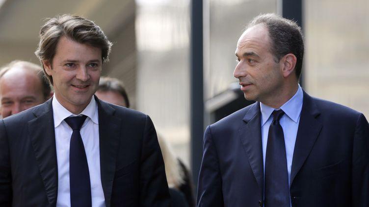 François Baroin (G) et Jean-François Copé, le 20 juin 2012 à Paris. (KENZO TRIBOUILLARD / AFP)