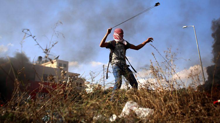 Affrontements entre soldats israéliens et palestiniens, le 14 octobre 2015 à Bethléem, en Cisjordanie. (SHADI HATEM / ANADOLU AGENCY / AFP)