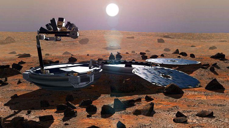 Une représentation artistique du robot Beagle 2 à la surface de Mars, réalisée en 2002 par l'Agence spatiale européenne. (AFP PHOTO / ESA / JIM WATSON)