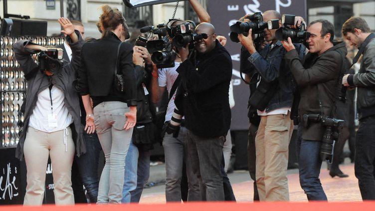 Top-model et photographes, à Paris le 15 septembre 2011 (NATHANAEL CHARBONNIER / FRANCEINFO / RADIOFRANCE)