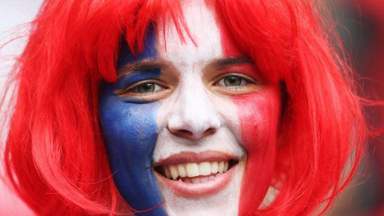 Une supportrice française lors des demi-finales du tournoi de football olympique féminin opposant la France au Japon, le 6 août 2012. (JOERN POLLER / FIFA / GETTY IMAGES)