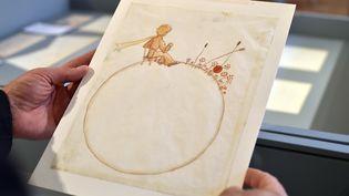 Cette toile du Petit Princesignée Antoine de Saint-Exupéry s'est adjugée284000 euros, le 14 juin 2017. (REMY GABALDA / AFP)