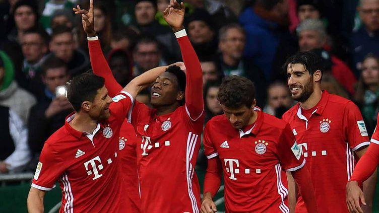Les joueurs du Bayern Munich balayent tout sur leur passage en Allemagne (PATRIK STOLLARZ / AFP)
