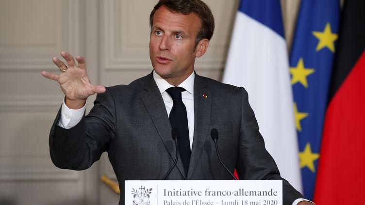 Emmanuel Macron, lors d'une conférence de presse à l'Elysée, le 18 mai 2020 à Paris. (FRANCOIS MORI / AFP)
