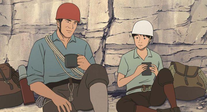Habu Jôji et son disciple Buntarô. Le film retrace le passé d'Habuet ses débuts comme alpiniste prometteur et talentueux. (ALLOCINE / WILD BUNCH DISTRIBUTION)