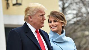 Donald et Melania Trump quitte une église de Washington (Etats-Unis), le 20 janvier 2017. (NICHOLAS KAMM / AFP)