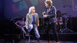 Les chanteurs Christophe et Julien Doré en décembre 2013 lors d'une soirée consacrée aux 50 ans de France Inter à la Gaîté Lyrique à Paris. (JULIEN HEKIMIAN / GETTY IMAGES EUROPE)
