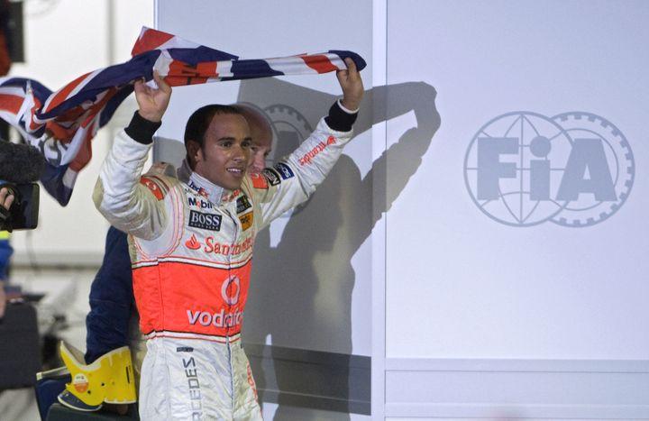 Un jeune Lewis Hamilton champion du monde pour la première fois en 2008 (ANTONIO SCORZA / AFP)