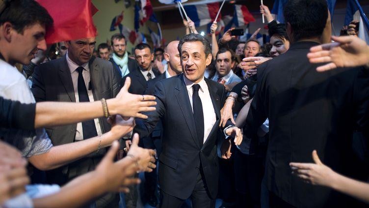 Nicolas Sarkozy, à son arrivée pour un meeting au Raincy (Seine-Saint-Denis), le 26 avril 2012. (LIONEL BONAVENTURE / AFP)