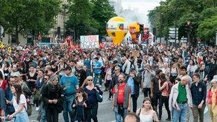 Des opposants à la loi Travail défilent à Paris, mardi 5 juillet 2016. (SERGE TENANI / CITIZENSIDE / AFP)