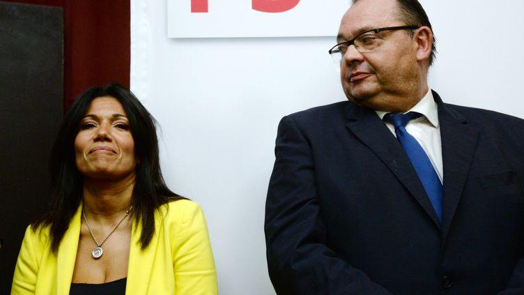 Patrick Mennucci, candidat socialiste à la mairie de Marseille, et sa rivale, Samia Ghali, à Marseille (Bouches-du-Rhône), le 20 octobre 2013. (ANNE-CHRISTINE POUJOULAT / AFP)