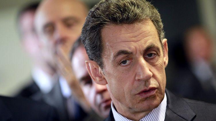 Nicolas Sarkozy lors de son déplacement à Bordeaux sur le thème des fraudeurs à la Sécurité sociale, le 15 novembre 2011. (REGIS DUVIGNAU / AFP)