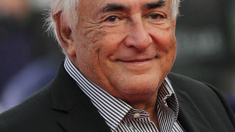 L'ex-directeur du Fonds monétaire international, Dominique Strauss-Kahn, au festival du film américain à Deauville (Calvados), le 13 septembre 2014. (CHARLY TRIBALLEAU / AFP)
