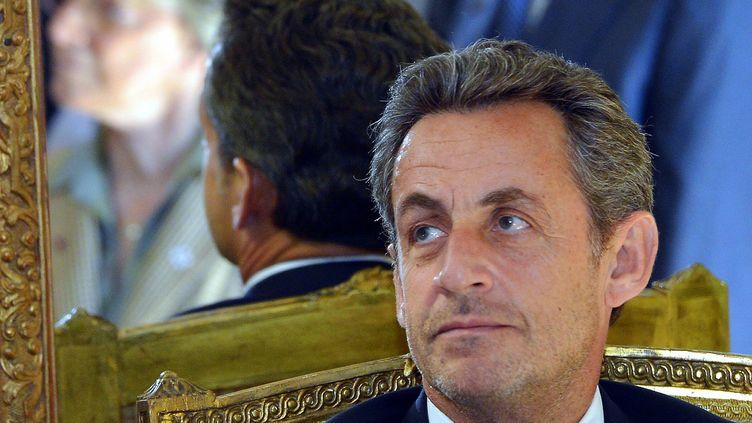 Nicolas Sarkozy, le 27 mars 2013, à Bruxelles (Belgique), lors d'une cérémonie au ministère des Affaires étrangères. (ERIC LALMAND / BELGA / AFP)