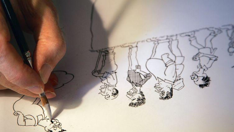 Cabu dessine, 15 mars 2006 (JOEL SAGET / AFP)