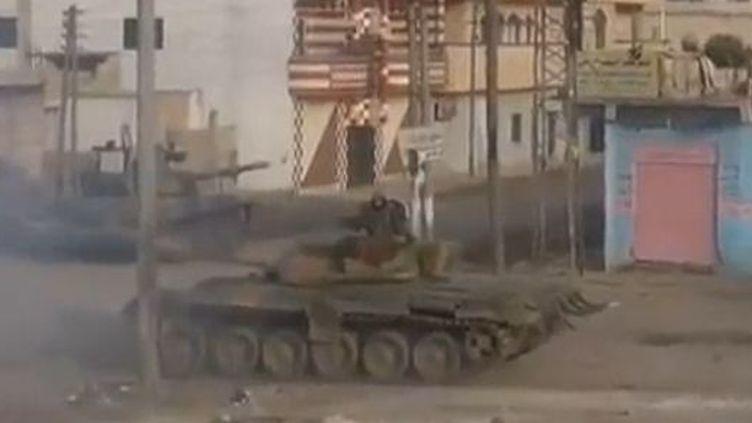Un char de l'armée syrienne, à Homs (Syrie), en décembre 2011. (FTVi)
