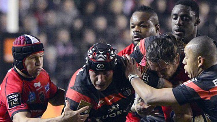 Les Toulonnais Gunther, Giteau et Bastareaud au contact des Toulousains Albacete, Fickou et Nyanga