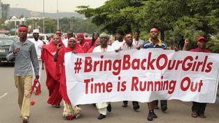 Une manifestation pour les lycéennes enlevées au Nigeria par la secte Boko Haram, dans les rues d'Abuja, vendredi 17 octobre 2014. (AFOLABI SOTUNDE / REUTERS )