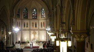 Le Pape François en visite aux Etats-Unis, le 24 septembre 2015, dans l'église St Patrick à Washington. (ALEX WONG / GETTY IMAGES NORTH AMERICA / AFP)