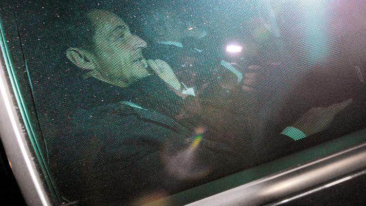 Nicolas Sarkozy quitte le palais de justice de Bordeaux (Gironde), le 22 novembre 2012, après son audition dans le cadre de l'affaire Bettencourt. (PIERRE ANDRIEU / AFP)