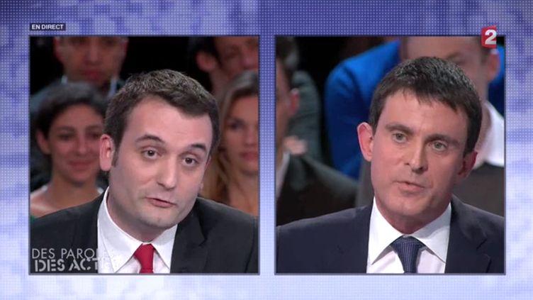 """Florian Philippot et Manuel Valls lors de l'émission """"Des paroles et des actes"""" sur France 2, le 6 février. ( FRANCE 2)"""