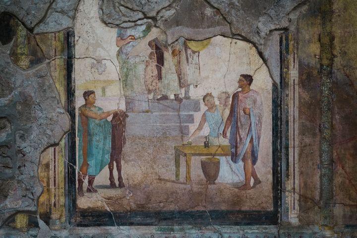 Une fresque dans La Maison des Cupidons d'Or, désormais visitable sur le site de Pompei (Italie), le 25 novembre 2019. (ELIANO IMPERATO / CONTROLUCE / AFP)