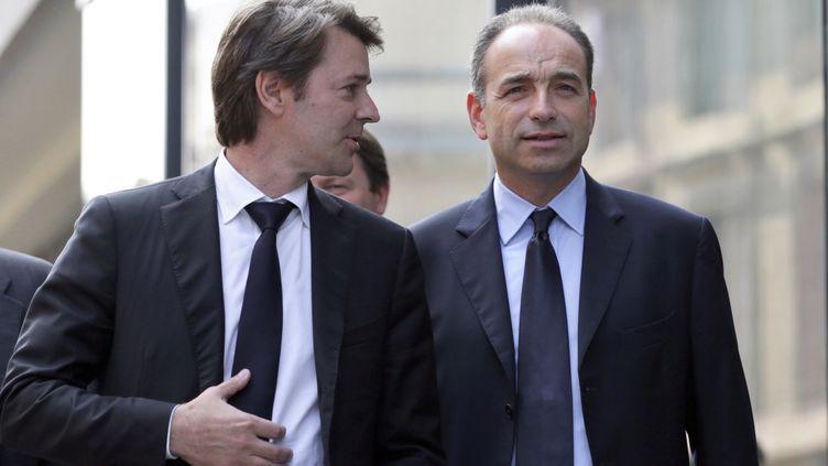 Lesleaders de l'UMP François Baroin et Jean-François Copé le 20 juin 2012 à Paris. (KENZO TRIBOUILLARD / AFP)