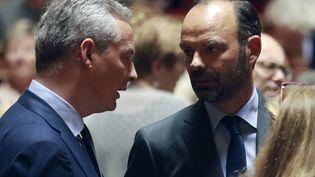 Le ministre de l'Economie, Bruno Le Maire, et le chef du gouvernement,Edouard Philippe, à l'Assemblée, le 6 juillet 2017 à Paris. (JACQUES DEMARTHON / AFP)