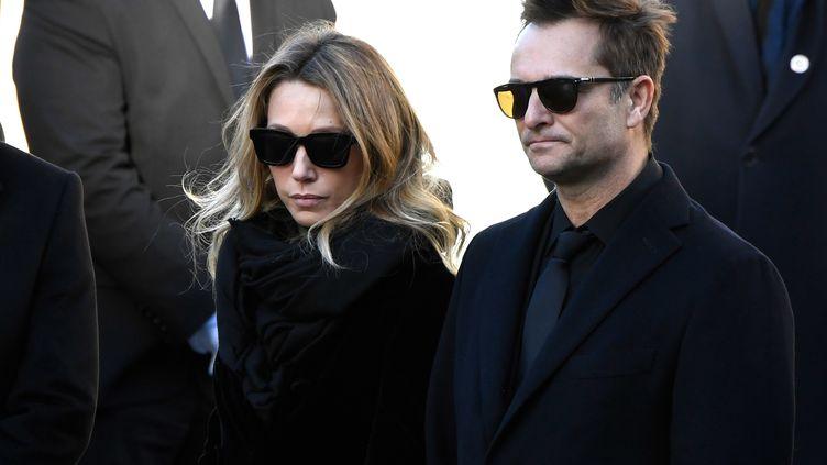 Laura Smet et David Hallyday assistent aux funérailles de leur père, Johnny Hallyday, le 9 décembre 2017, à Paris. (BERTRAND GUAY / AFP)