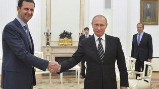 Les présidentssyrien et russe, Bachar Al-Assad et Vladimir Poutine, au Kremlin, à Moscou (Russie), le 20 octobre 2015. (RIA NOVOSTI / REUTERS)