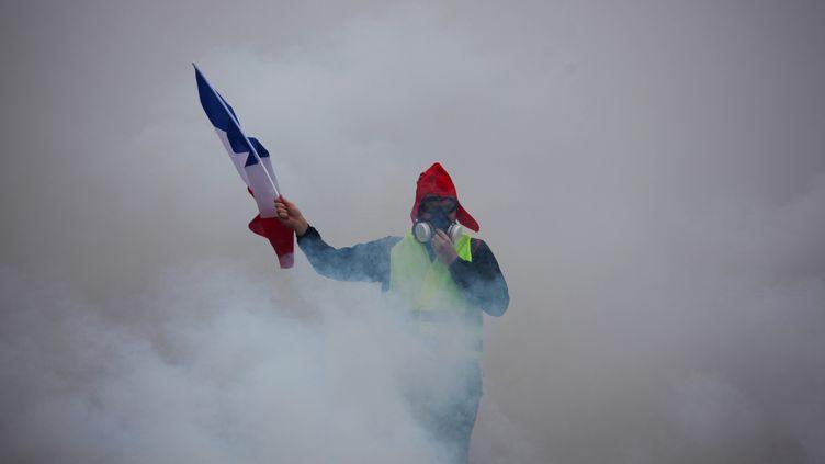 """Un """"gilet jaune"""" à Paris, le 1er décembre 2018. (AFP)"""