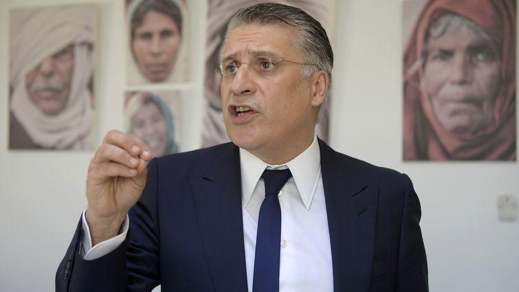 Le patron de la chaîne privée Nessma TV et candidat à la présidentielle Nabil Karoui à son bureau de Tunis le 18 juin 2019 (FETHI BELAID / AFP)