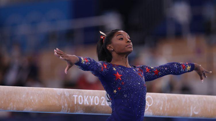La gymnaste américaine Simone Biles prend part auxépreuves de qualification lors des Jeux olympiques de Tokyo, au Japon, le 25 juillet 2021. (KUNIHIKO MIURA / YOMIURI / AFP)