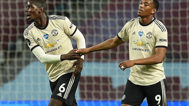Paul Pogba et Anthony Martial sont deux Internationaux français qui jouent à Manchester United, l'un des clubs anglais fondateurs de la Super Ligue. (OLI SCARFF / POOL)
