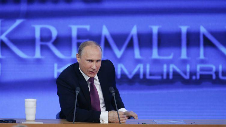 Vladimir Poutine, le 18 décembre 2014, à Moscou (Russie), lors de sa conférence de presse annuelle. ( MAXIM ZMEYEV / REUTERS )