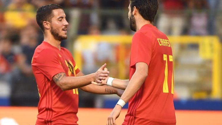 Eden Hazard (à g.) et Yannick Ferreira-Carrasco. (EMMANUEL DUNAND / AFP)