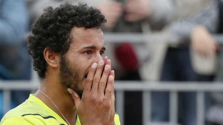 Laurent Lokoli sort grandi de son premier tournoi du Grand Chelem (PATRICK KOVARIK / AFP)
