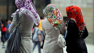 Des femmes portant le voile, à Cologne (Allemagne), le 20 juillet 2011. (OLIVER BERG / DPA / AFP)