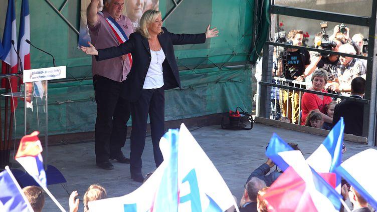 Marine Le Pen lors de son discours de rentrée politique à Brachay (Haute-Marne), le 30 août 2014 (FRANCOIS NASCIMBENI / AFP)