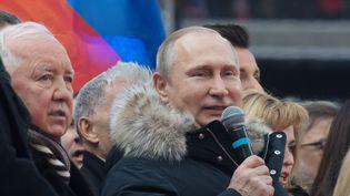 Vladimir Poutine lors d'un meeting organisé le 3 mars 2018 au stade olympique de Moscou (Russie). (SERGEY GUNEEV / SPUTNIK / AFP)