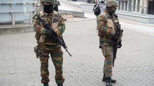 Des policiers dans les rues de Bruxelles, mardi 22 mars 2016. (ARNULF STOFFEL / DPA / AFP)