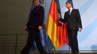 La chancelière allemande, Angela Merkel, et le président français, Nicolas Sarkozy (AFP PHOTO / JOHANNES EISELE)