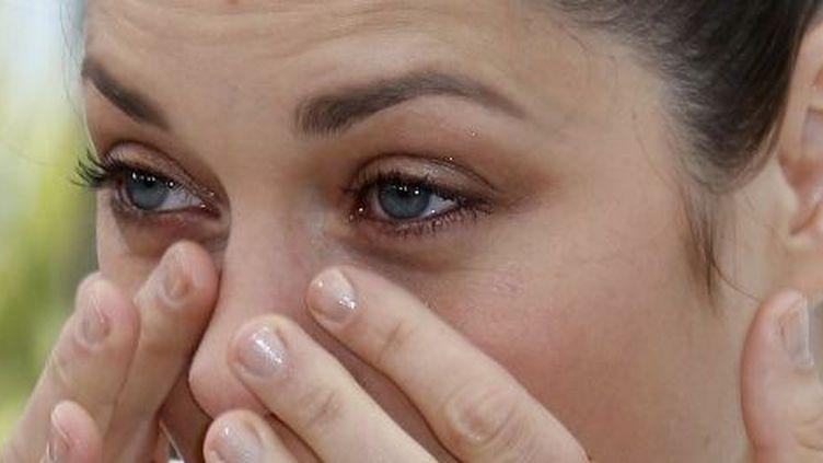 """Les larmes de Marion Cotillard, durant la séance photo de """"The Immigrant""""  (Valérie Hache/AFP)"""