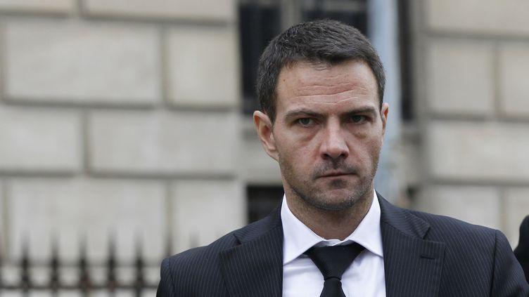 Jérôme Kerviel arrive au palais de justice, à Paris, pour le verdict de son procès en appel, le 24 octobre 2012. (GONZALO FUENTES / REUTERS)